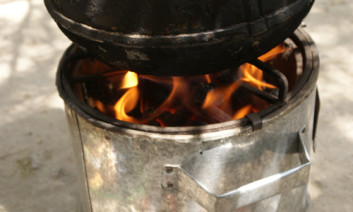 While cooking using firewood, this burner produces charcoal