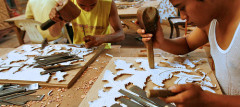 Men carve a pattern from a paper template. Jepara, Central Java, Indonesia. Photo by Murdani Usman/CIFOR via Flickr